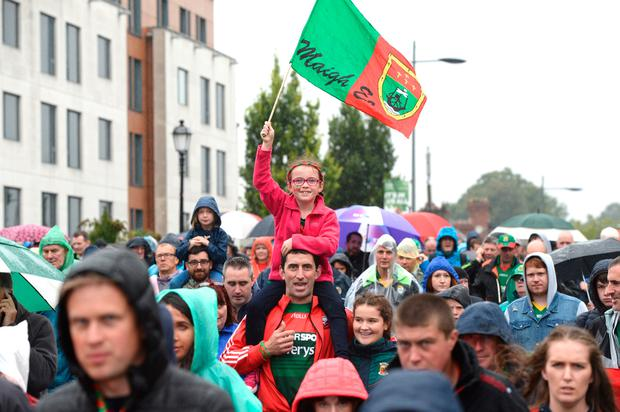 Mayo fan Orla Madden (8) flies the flag with her father Padraic from Ballycastle after the epic battle. Photo: Justin Farrelly