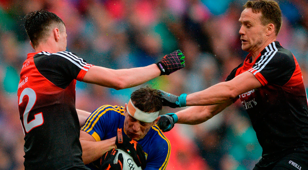 Mayo duo Diarmuid O'Connor (left) and Andy Moran collide with Kerry's David Moran. Photo: Sportsfile