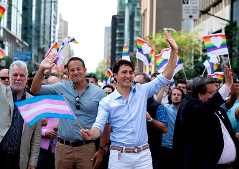 Taoiseach Leo Varadkar joins in the Pride march through Montreal with Canadian Prime Minister Justin Trudeau. Photo: Reuters