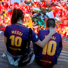 People gather at an impromptu memorial at Las Ramblas in Barcelona, Spain Photo: Reuters