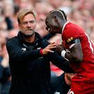 Sadio Mane leaps in celebration towards manager Jurgen Klopp during Saturday's victory against Crystal Palace Photo: PA