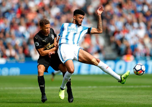 Newcastle United's Dwight Gayle in action with Huddersfield Town's Philip Billing Photo: Reuters