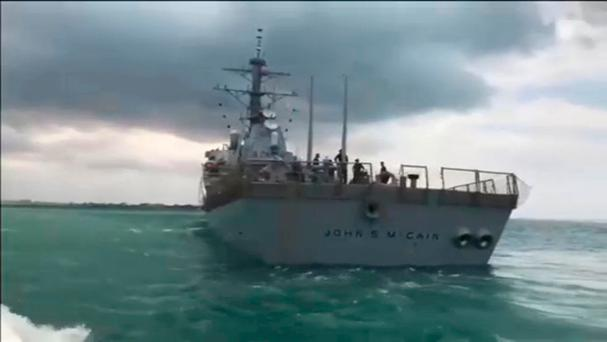The U.S. Navy guided-missile destroyer USS John S. McCain is seen after a collision, in Singapore waters in this still frame taken from video August 21, 2017. REUTERS/Reuters TV