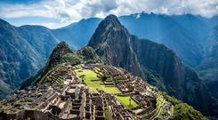 Aerial view of Macchu Picchu ruins in remote landscape, Cusco, Peru