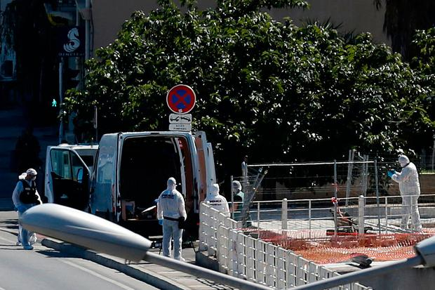 French police conduct their investigation in the French port city of Marseille after one person was killed and another injured after a vehicle crashed into two bus shelters, in Marseille, France, August 21, 2017. REUTERS/Philippe Laurenson