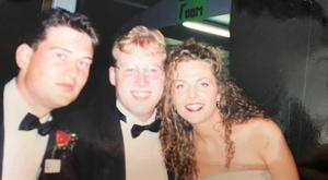 Damien O'Reilly (centre) with the Dublin Rose and her escort 1996