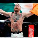 Nov 2016: Conor McGregor celebrates after defeating Eddie Alvarez by second round TKO following their lightweight title bout at UFC 205 in Madison Square Garden, New York. Photo by Adam Hunger/Sportsfile
