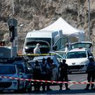 French police cordon off the area after a van, center, rammed into two bus stops in the French port city of Marseille. (AP Photo/Claude Paris)