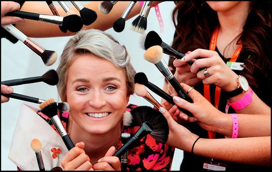 Queensland Rose Ellen McCready having her make up applied at the Rose of Tralee International Festival in Tralee Co Kerry. Pic Steve Humphreys