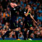 Everton's Wayne Rooney (left) celebrates scoring his side's first goal