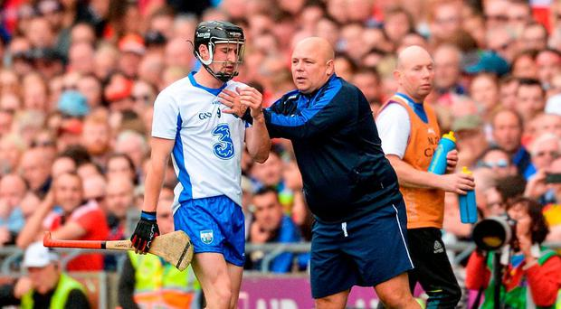 Conor Gleeson of Waterford, with manager Derek McGrath, and Patrick Horgan of Cork leave the field after being sent by referee James Owens late in the game during the GAA Hurling All-Ireland Senior Championship Semi-Final match between Cork and Waterford at Croke Park in Dublin. Photo by Piaras Ó Mídheach/Sportsfile