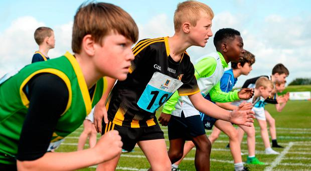 19 August 2017; Mike Galvin, from left, from Duagh Lyre Co Kerry, Patrick Lacey, from Dicksboro, Co Kilkenny and John Ikpotokin, from Portarlington, Co Laois, line up for the U12 Boys 100 Metres Race during day 1 of the Aldi Community Games August Festival 2017 at the National Sports Campus in Dublin. Photo by Cody Glenn/Sportsfile