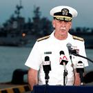 Admiral Scott Swift, Commander of the U.S. Pacific Fleet, speaks at a news conference near the damaged USS John McCain and the USS America at Changi Naval Base in Singapore August 22, 2017. REUTERS/Calvin Wong