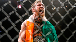 Conor McGregor celebrates after defeating Chad Mendes