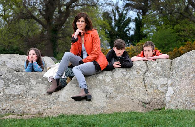 Writer Emily Hourican pictured with her three children, Bee (6) , Malachy (13) and Davy (9) in Deer Park , Stillorgan. Photo: Frank Mc Grath