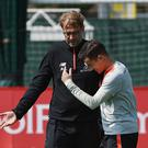 LIVERPOOL, ENGLAND - MAY 05: (THE SUN OUT, THE SUN ON SUNDAY OUT) Jurgen Klopp manager of Liverpool talking with Philippe Coutinho during a training session at Melwood Training Ground on May 5, 2017 in Liverpool, England. (Photo by Andrew Powell/Liverpool FC via Getty Images)
