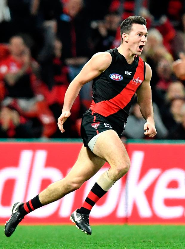 Conor McKenna playing for Essendon last weekend against the Gold Coast Suns. Photo: Bradley Kanaris/Getty Images