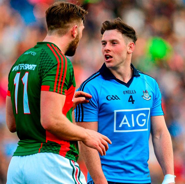 Philly McMahon arguing the toss with Mayo's Aidan O'Shea during their 2015 clash. Photo: Piaras Ó Mídheach / Sportsfile
