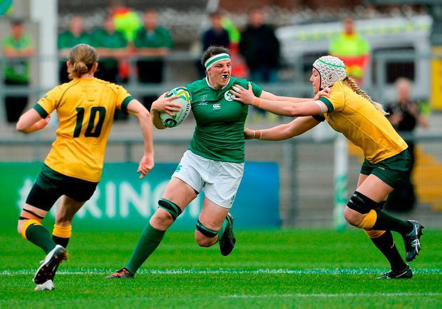 Paula Fitzpatrick holds off a tackle from Australia's Chloe Butler. Photo: Oliver McVeigh/Sportsfile