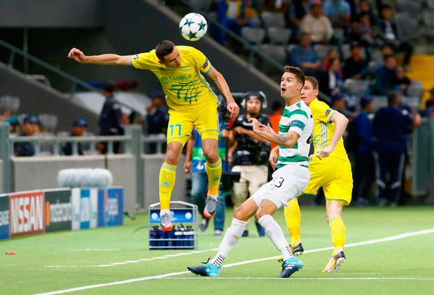 FC Astana's Dmitri Shomko heads the ball away from Mikael Lustig. Photo: REUTERS/Shamil Zhumatov