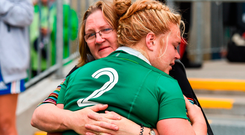 A disappointed Cliodhna Moloney is comforted by her mother Moira after the defeat to Australia. Photo: Sportsfile