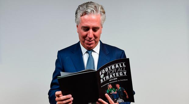 FAI Chief Executive John Delaney looks through the Football For All booklet during the Football For All Strategic Plan Launch at the Marker Hotel in Dublin. Photo: David Fitzgerald/Sportsfile