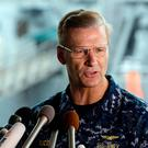U.S. Navy Vice Adm. Joseph Aucoin, Commander of the U.S. 7th Fleet, speaks during a press conference, with damaged USS Fitzgerald as background at the U.S. Naval base in Yokosuka, southwest of Tokyo. U.S. officials said that Aucoin is to be relieved of duty after series of ship accidents in the Pacific. (AP Photo/Eugene Hoshiko, File)