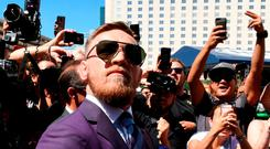 UFC lightweight champion Conor McGregor arrives at Toshiba Plaza in Las Vegas yesterday