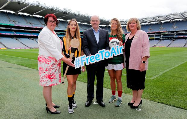 Minister for Communications, Climate Action and Environment, Denis Naughten with (L-R) President of the Camogie Association, Catherine Neary, Kilkenny's Miriam Fribsy, Mayo's Sarah Rowe and Ladies Gaelic Football Association President, Marie Hickey at Croke Park in Dublin. Photo: Maxwells