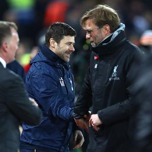 LIVERPOOL, ENGLAND - FEBRUARY 11: Jurgen Klopp, Manager of Liverpool and Mauricio Pochettino, Manager of Tottenham Hotspur shake hands prior to the Premier League match between Liverpool and Tottenham Hotspur at Anfield on February 11, 2017 in Liverpool, England. (Photo by Clive Brunskill/Getty Images)