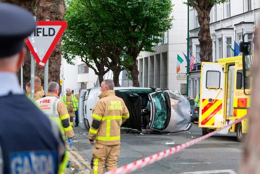 The silver Saab was left on its side after the crash in Dublin. Photo: Colin O'Riordan