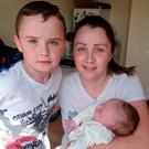 Nadine Mulligan (28) with her children Jamie-Lee (8) and Liam (9 weeks). Photo: Ciara Wilkinson