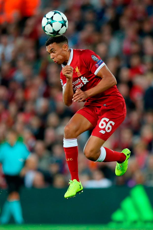 Trent Alex Arnold of Liverpool heads the ball. Photo: Getty Images