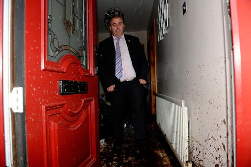 Minister Kevin 'Boxer' Moran inspects a damaged home in Burnfoot. Photo: Caroline Quinn