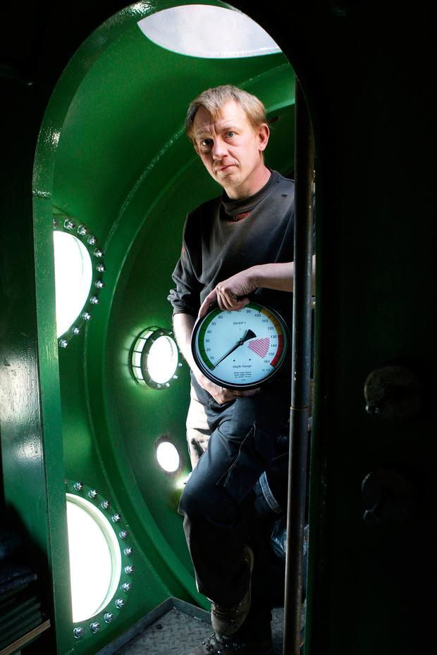 Submarine owner Peter Madsen stands inside the vessel. Photo: AP
