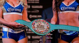 The victor's belt is displayed during a press conference with boxer Floyd Mayweather Jr. and MMA figher Conor Mcgregor