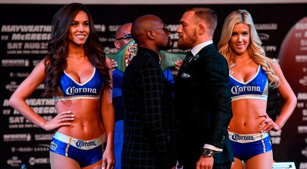 Conor McGregor and Floyd Mayweather square off during yesterday's news conference at the MGM Grand in Las Vegas. Stephen McCarthy/Sportsfile