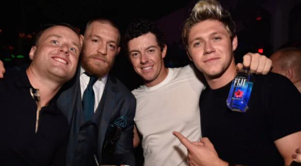 Rory McIlroy (centre right) celebrates with Conor McGregor after his UFC 202 victory. CREDIT: INSTAGRAM