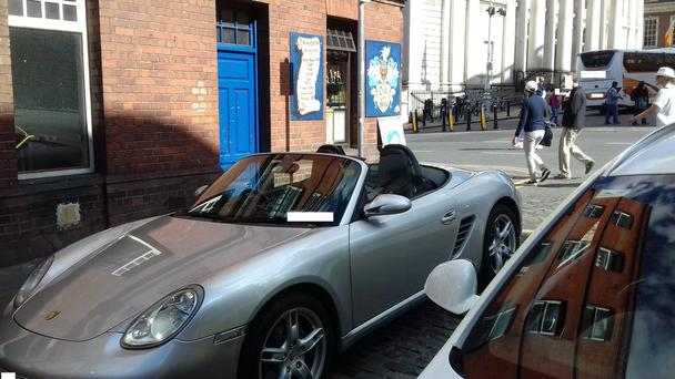 A convertible parked in a disabled bay without a permit. Picture@GardaTraffic