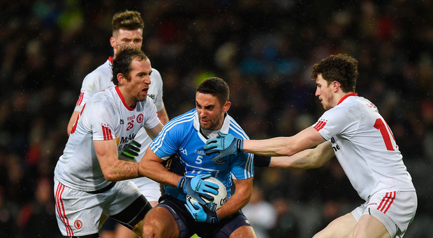 11 February 2017; James McCarthy of Dublin in action against Justin McMahon, left, and Rory Brennan of Tyrone during the Allianz Football League Division 1 Round 2 match between Dublin and Tyrone at Croke Park in Dublin. Photo by Ray McManus/Sportsfile