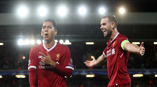 LIVERPOOL, ENGLAND - AUGUST 23: Roberto Firmino of Liverpool celebrates scoring his sides fourth goal with Jordan Henderson of Liverpool during the UEFA Champions League Qualifying Play-Offs round second leg match between Liverpool FC and 1899 Hoffenheim at Anfield on August 23, 2017 in Liverpool, United Kingdom. (Photo by Mark Robinson/Getty Images)