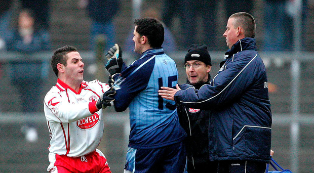 5 February 2006; Dublin's Alan Brogan confronts Tyrone's Michael McGee while Tyrone doctor Seamus Cassidy and Dublin manager Paul Caffrey intervene. Allianz National Football League, Division 1A, Round 1, Tyrone v Dublin, Healy Park, Omagh, Co. Tyrone. Picture credit: Oliver McVeigh / SPORTSFILE