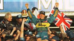 MICHAEL SCHUMACHER OF GERMANY IS LIFTED ABOVE THE CROWD BY HIS BENETTON TEAM AND FANS AS HE CELEBRATES AFTER WINNING THE PACIFIC GRAND PRIX AND HIS SECOND WORLD DRIVERS CHAMPIONSHIP AT AIDA IN SUZAKA, JAPAN. Mandatory Credit: Pascal Rondeau/ALLSPORT