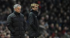 Manchester United's Portuguese manager Jose Mourinho (L) an Liverpool's German manager Jurgen Klopp watch the players from the touchline during the English Premier League football match between Manchester United and Liverpool at Old Trafford in Manchester, north west England, on January 15, 2017. / AFP / Oli SCARFF