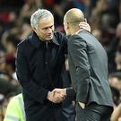 Manchester United's Portuguese manager Jose Mourinho (L) shakes hands with Manchester City's Spanish manager Pep Guardiola after the EFL (English Football League) Cup fourth round match between Manchester United and Manchester City at Old Trafford in Manchester, north west England on October 26, 2016. AFP / Oli SCARFF