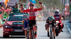 Lotto Soudal's Polish cyclist Tomasz Marczynski celebrates as he crosses the line to win stage six of the Vuelta. Photo: Getty Images