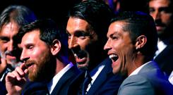 Lionel Messi, Gianluigi Buffon and Cristiano Ronaldo share a joke at yesterday's draw for the Champions League group stages. Photo: Reuters