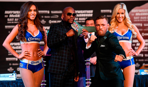 Conor McGregor and Floyd Mayweather Jr square off during a news conference at the MGM Grand in Las Vegas, USA, ahead of their super welterweight boxing match at T-Mobile Arena in Las Vegas. Pic: Sportsfile