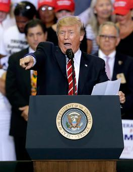 President Donald Trump speaks at a rally at the Phoenix Convention Center, Tuesday, Aug. 22, 2017, in Phoenix. (AP Photo/Rick Scuteri)