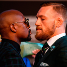 McGregor and Floyd Mayweather square off at the final press conference before the bout. Picture: Sportsfile